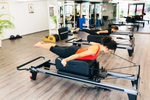 Women working out in a pilates gym